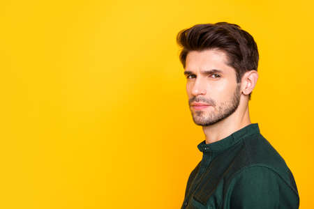 Profile side portrait of serious elegant guy look listen feel dreamy emotions wear casual style clothing isolated over yellow color background