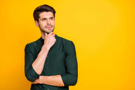 Portrait of gorgeous brutal masculine worker think try solve work job problems touch his chin wear casual outfit isolated over bright color background