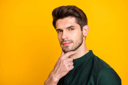 Close up photo of pensive minded worker guy touch his chin think about future start-up projects wear casual style clothing isolated over yellow color background