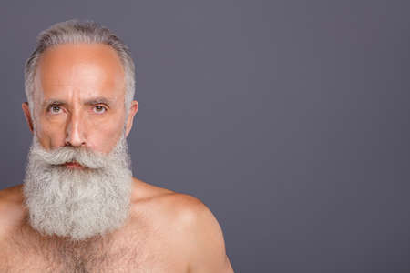 Close up photo of virile brutal mature man grandfather standing naked staring at you intently near empty space isolated over grey color background