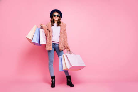 Milan I love you. Full length photo of pretty model lady carry many packs enjoy abroad sales shopping wear fluffy jacket jeans sun specs hat shoes isolated pink background Stok Fotoğraf