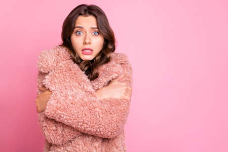 Photo of amazing millennial model lady hugging herself unexpected chilly weather wearing stylish youth fluffy autumn jacket isolated pink background 스톡 콘텐츠