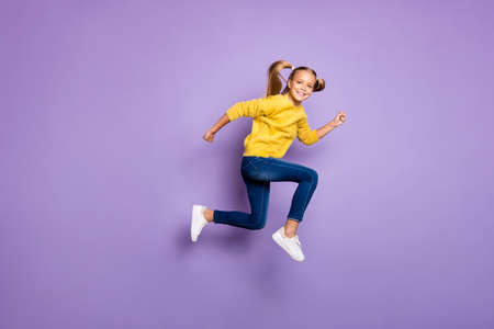 Full body photo of cheerful sweet kid jump run after black friday bargains wear casual style clothing isolated over purple color background