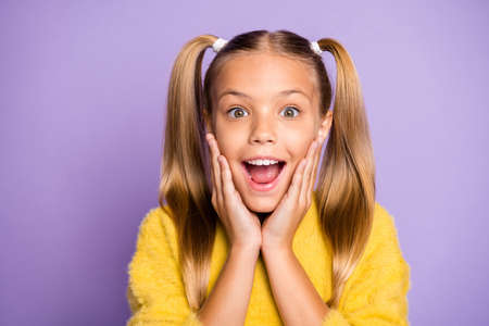 Photo of cheerful ecstatic overjoyed girl unable to believe that sales started expressing astonishment on face wearing yellow sweater isolated pastel violet color background