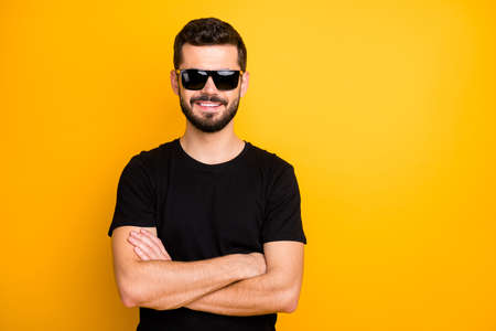 Portrait of positive cheerful guy cross hands real freelancer entrepreneur enjoy rest relax wear good looking outfit black friday isolated over vibrant color background Stock Photo