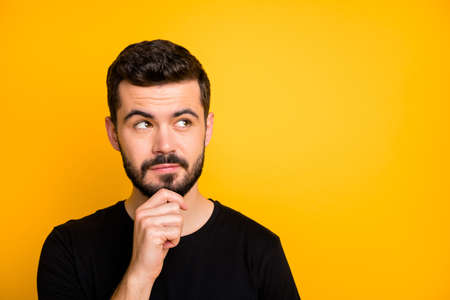 Close up photo of focused minded guy think thoughts black friday touch chin hands look copyspace wear casual style outfit isolated over shine color background