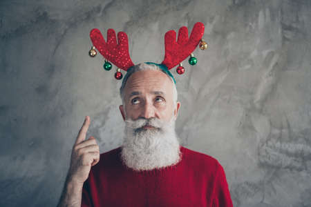 Portrait of negative minded stylish old man wear deer headband point index finger dislike x-mas christmas party costume isolated over grey color background
