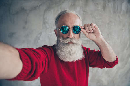 Close up photo of serious harsh masculine luxury old man have x-mas christmas traveling celebration make selfie touch specs wear modern jumper isolated over grey color background