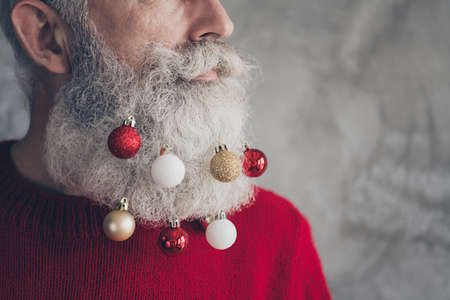 Cropped profile side photo of masculine brutal old man look gorgeous on christmas party hang x-mas red gold baubles beard wear modern pullover isolated over grey color background