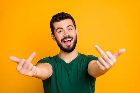 I ignore you haters. Carefree guy want keep soul balance show fuck offensive sign enemies feel crazy furious scream wear modern youngster clothing isolated over vibrant color background