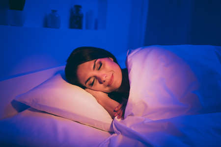 Close-up portrait of her she nice attractive charming lovely cute dreamy brunet girl lying in bed covered white duvet sleeping peacefully at night room house flat apartment hotel indoors