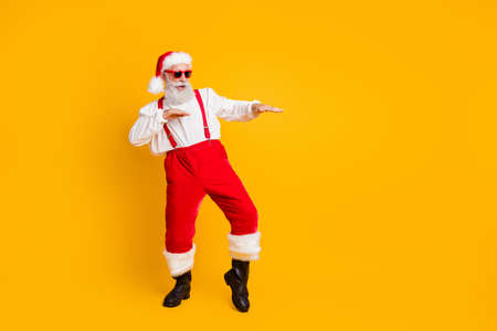 Full size photo of funny crazy cool santa claus fairy hipster clubber enjoy x-mas christmas time party dance wear stylish shirt suspenders trousers isolated over yellow color background
