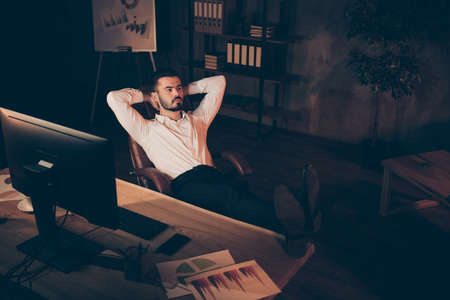 Full length body size top above high angle photo of serious confident pensive coach pondering over how not to become bankrupt and to reduce costs with legs on table Foto de archivo