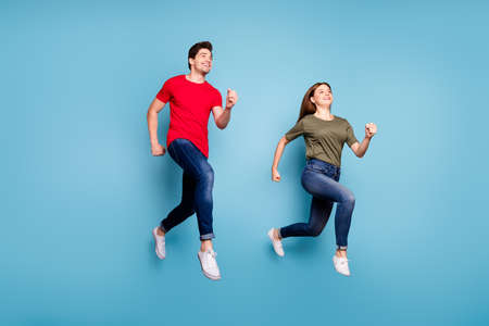 Full body photo of two spouses relax rest jump run wear casual style outfit isolated over blue color background