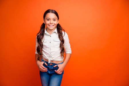 Portrait of charming lovely kid having fun stand feel candid on fall weekends wear casual style clothing isolated over bright color background Stock Photo