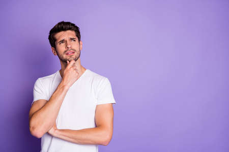 Portrait of his he nice attractive lovely suspicious brunette guy touching chin thinking copy space isolated on purple violet lilac color pastel background