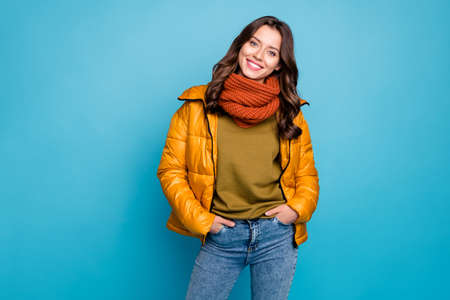 Photo of amazing millennial lady easy-going person holding hands pockets wear modern stylish autumn windbreaker jeans scarf isolated blue color background