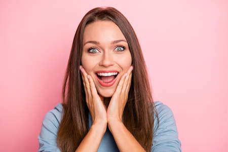 Close up photo of cheerful positive cute nice pretty girlfriend smiling toothily expressing emotions on face in blue sweater isolated pink pastel color background