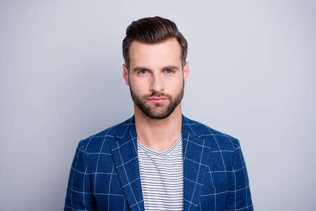 Close-up portrait of his he nice well-groomed serious attractive calm bearded guy wearing checked blazer isolated over light grey pastel color background Фото со стока