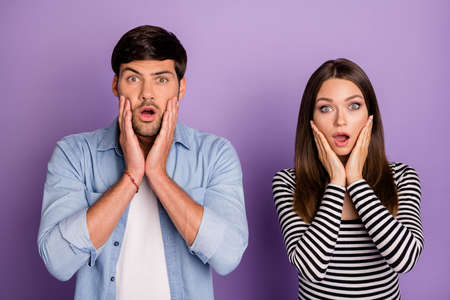 Photo of two people couple holding arms on cheeks listen negative awful terrible news wear stylish casual outfit isolated pastel purple color background Фото со стока - 134706822