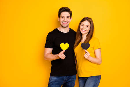 Photo of cheerful cute sweet pretty cute girl wearing t-shirt jeans denim holding each other hearts smiling toothily hugging isolated over vivid color background Stock Photo