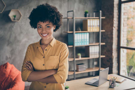 Portrait of cool afro american girl start-up representative agent cross hands ready decide workforce solution in enterprise office loft