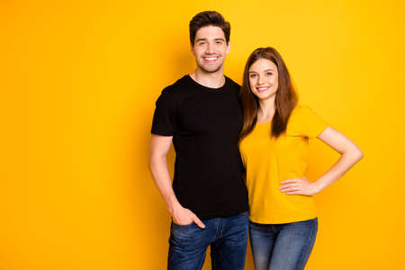 Photo of cheerful positive nice cute pretty couple hugging with man holding hand in jeans denim pocket smiling toothily isolated over vivid color background