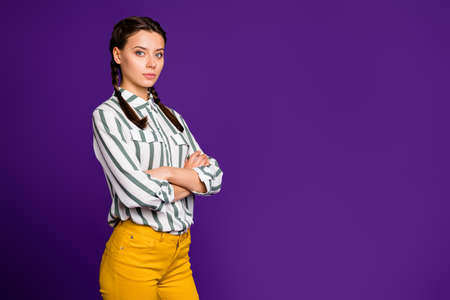 Profile photo of beautiful business lady holding hands crossed responsible person seriously looking colleagues wear striped shirt yellow trousers isolated purple color background