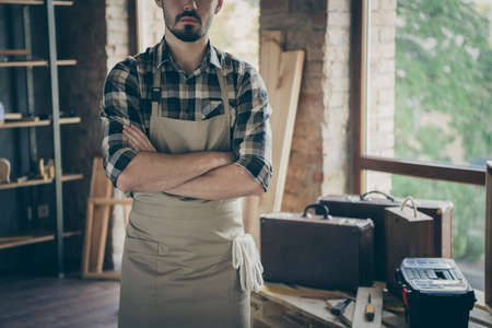 Cropped photo of self-confident strict guy master arms crossed standing near working equipment owner wooden business industry studio woodwork shop garage indoors