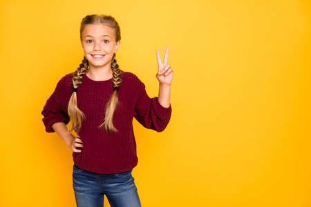 Portrait of her she nice attractive charming cute lovely pretty winsome, cheerful cheery pre-teen girl showing v-sign isolated over bright vivid shine vibrant yellow color background Фото со стока