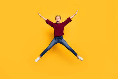 Full length body size photo of cheerful screaming overjoyed girl shaping, star with legs arms jumping isolated vivid color background