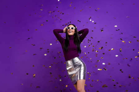 Photo of cheerful cute pretty nice charming attractive girl hanging out in night club in skirt isolated vibrant dancing purple color background