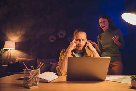 Portrait of his he her she nice attractive spouses mad girl tired guy working self developing having crisis scolding fight at night dark home house living-room apartment Zdjęcie Seryjne