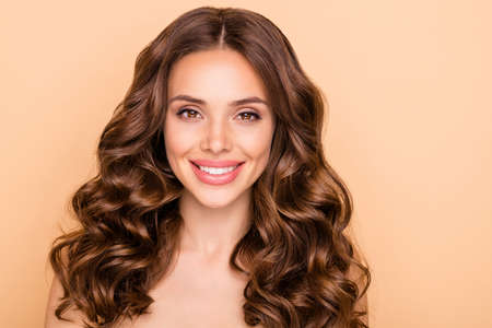 Close-up portrait of her she nice-looking attractive lovely cheerful cheery wavy-haired girl fresh soft skin laser peeling ayurveda anti acne isolated over beige pastel color background Stock fotó