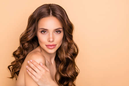 Close-up portrait of nice attractive feminine sensual gorgeous wavy-haired girl touching soft silky shoulder domestic house daily procedure clay bath mask isolated on beige pastel color background