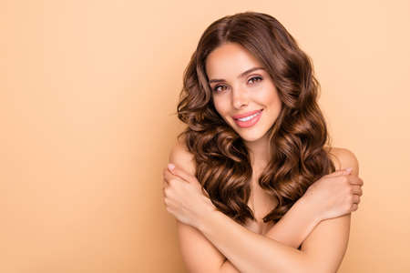 Close-up portrait of nice attractive cute feminine sensual gorgeous cheerful wavy-haired girl touching soft silky skin salon procedure peeling vitamin complex isolated on beige pastel color background