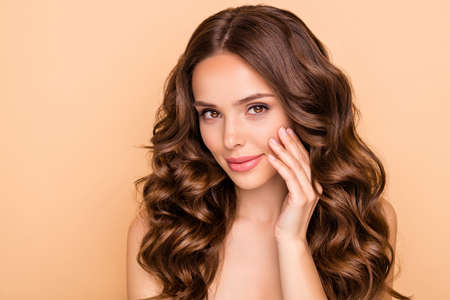 Close-up portrait of her she nice-looking attractive cute tender feminine sensual wavy-haired girl touching cheek new modern laser peeling effect therapy isolated over beige pastel color background