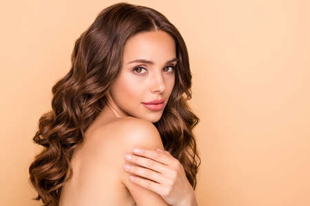 Close up photo of attractive lady touch her shoulder skin enjoy spa salon treatment procedure isolated over beige color background Archivio Fotografico - 135268605