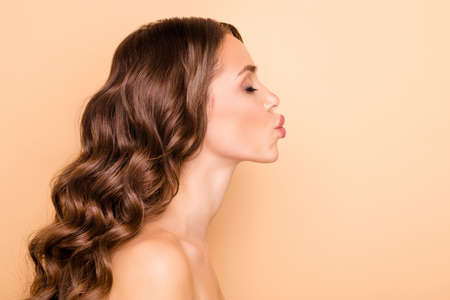 Profile side photo of dreamy joyful girl send air kiss show lifting procedure ideal lips form want be romantic romance isolated over pastel color background Archivio Fotografico - 135268609