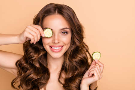 Close up photo of charming wavy haired girl close her eyes with cucumber slices want have vegetable vitamin treatment isolated over pastel color background Archivio Fotografico - 135268611