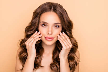 Close-up portrait of her she nice-looking attractive lovely feminine sensual shine pure wavy-haired girl applying day daily night vitamin gel cream isolated over beige pastel color background