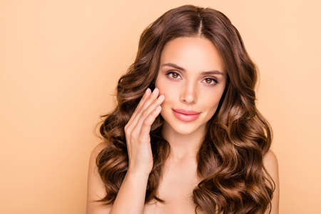Close-up portrait of her she nice-looking attractive lovely feminine sensual wavy-haired girl touching soft smooth perfect cheek laser peeling effect isolated over beige pastel color background