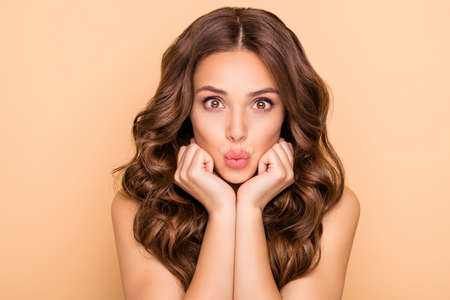 Close-up portrait of her she nice-looking attractive lovely feminine sensual cheerful funny girlish wavy-haired girl sending kiss pout lips organic detox isolated over beige pastel color background Stock Photo