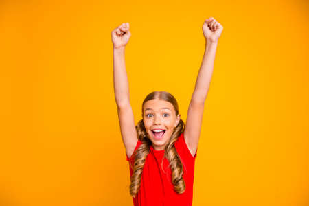 Photo of overjoyed crazy pretty little lady raising hands up triumphing screaming best cheerleader fan wear casual red t-shirt isolated bright yellow color background