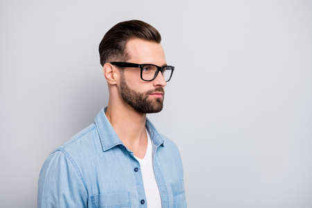 Closeup photo of amazing macho guy serious looking empty space young promoted boss chief wear specs casual denim outfit isolated grey color background