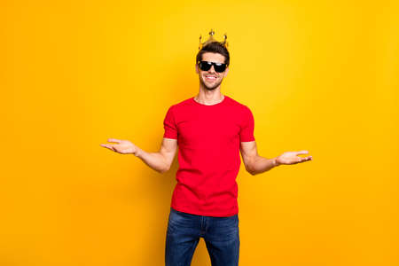 Portrait of cheerful charming cool guy real prom king hold hand want hug his friend celebrate his prom win coronation wear denim jeans outfit isolated over yellow color background Zdjęcie Seryjne