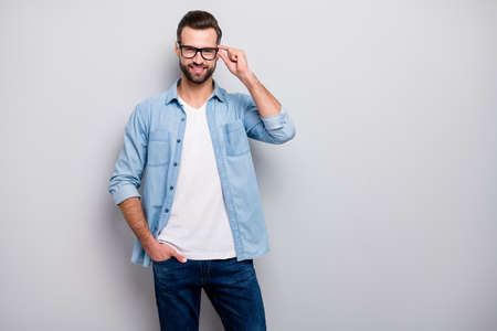 Photo of attractive macho guy perfect appearance neat hairstyle bristle young promoted boss chief easy-going person wear casual denim outfit isolated grey color background
