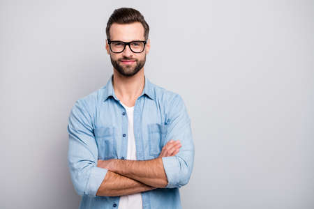 Photo of positive business guy young boss chief hands crossed self-confident person friendly smiling colleagues partners wear specs casual denim outfit isolated grey color background Reklamní fotografie