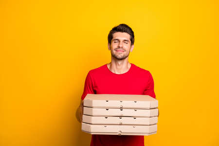 Yummy pizza. Peaceful content guy hold pile stack boxes smell scent from delicious pie wear casual style clothing isolated over bright color background
