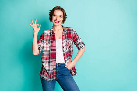 Portrait of positive cheerful cool girl promoter show okay sign recommend ads promo suggest select perfect sales wear casual style outfit isolated over teal color background